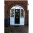 The Glasgow Composite Door in Black with Arched Frame
