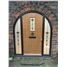 The Taunton Composite Door in Arched Frame in Oak with Fleur and matching surround