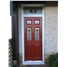 The Oxford Composite Door in Red with Fleur and Bespoke Glass Toplight