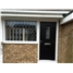 The Taunton Composite Door in Black with Clear Glazing and Window